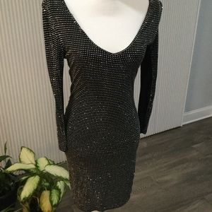 Bebe Dresses - Bebe Black Metallic sexy short dress